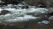 Spring Fed Creek Flows Fast Over Rocks