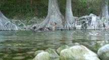 Family Enjoying Summer In Guadalupe River, Texas Hill Country