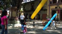 Plaza Central, Oaxaca, Mx, Kids Playing With Tube Balloons