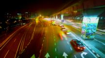 Motion Track Time Lapse Of Night Time Traffic In Bangsar Malaysia. A Busy Scene Including Cars Trains And The Monorail.