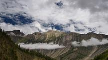 Clouds Forming Against A Huge Cliff In Bratang Nepal