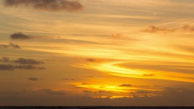 sunrise and clouds over ocean time-lapse