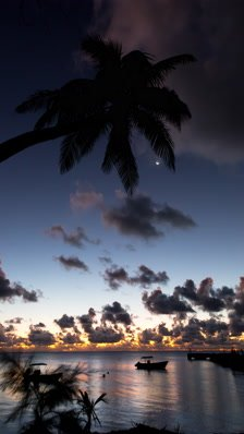 Large Vertical format Time lapse of dusk in tropical island setting