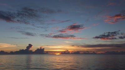 Timelapse of sunset over ocean