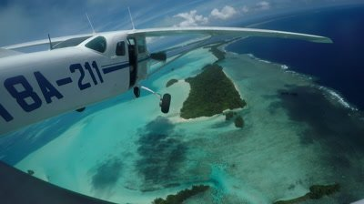 Fixed action cam shot on board light aircraft as it flies over Palau's Tropical islands