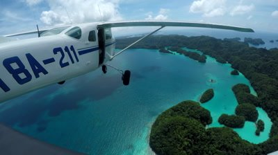 action cam mounted on light aircraft as it flies over Palau's Milky Way and tropical islands