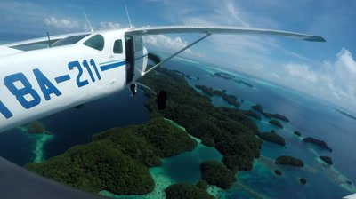 Action cam mounted on light aircraft as it flies over Palau's tropical islands
