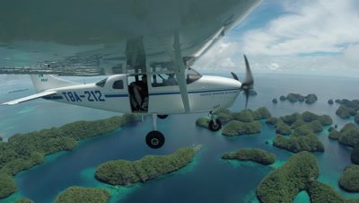 Action cam mounted to wing of light aircraft as it flies over Palau's UNESCO World heritage site site