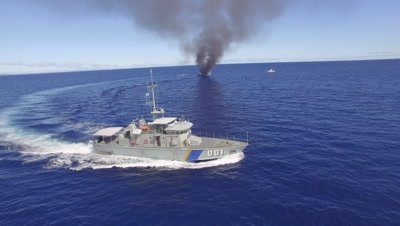 Palau's patrol boat circles burning illegal fishing boat