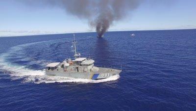 Palau's patrol boat circles burning illegal fishing boat