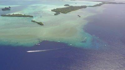 Aerial drone shot of Palau dive sites Blue Corner and Blue Holes descending towards Blue Holes