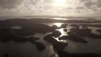 Climbing aerial shot over tropical islands in late afternoon
