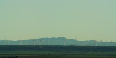 Wind Turbines - farm on horizon,wide