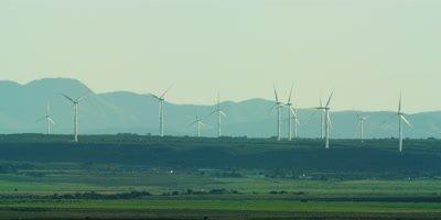 Wind Turbines - farm on horizon,medium wide 2