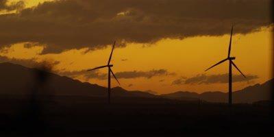 Wind Turbines - silhouette against orange sky,sunset