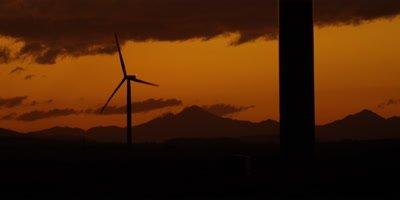 Wind Turbines - silhouette against orange sky,sunset 4