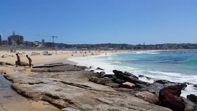 Bondi Beach or Bondi Bay is a popular beach on a hot summers in Sydney, Australia. Bondi is one of Australia's most popular beaches.