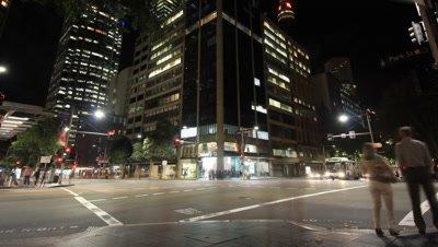 City Street Night Traffic and Commuter Pedestrian Time Lapse - Sydney City Australia