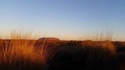 Uluru, or Ayers Rock, is a massive sandstone monolith in the heart of the Northern Territory and is an iconic Australian desert landmark within the outback red desert landscape of the Uluru-Kata Tjuta National Park.