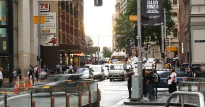 Establishing shot footage of busy city street vehicle car traffic transport congestion during commuter rush hour or peak hour timelapse with slow shutter to get the blurred motion effect. George St Sydney Australia day but would suit any generic city street scene.