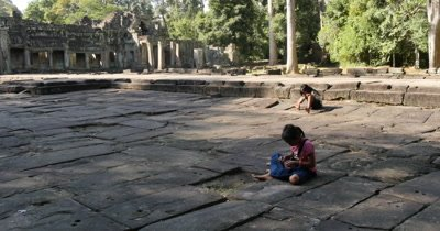 Two young asian Cambodia girls playing with string making a ring, enjoying childhood and having fun as childern.