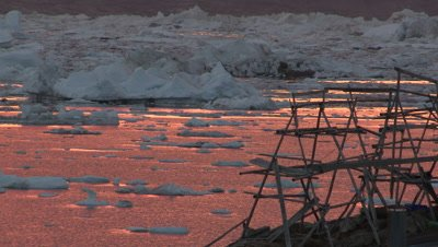 Sunset on the east coast of Greenland,inuit village along the fjord