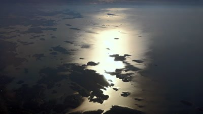 Sunrise over Finland with small islands in the Baltic sea, aerial view