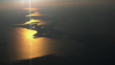 Sunset over the Baltic sea, silhouette of landmark, aerial view