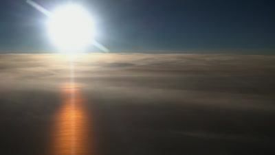 Sunset over the Baltic sea, sun over layer of clouds and reflection on the sea, aerial view