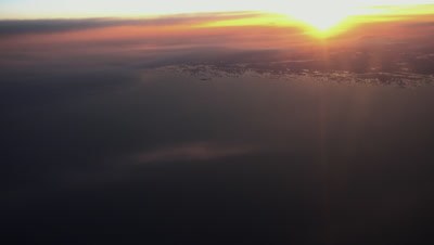 Sunset over the Baltic sea, outline of the coast of Finland, aerial view