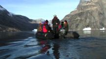 Tourists On Inflatable Boat In A Remote Fjord Of Greenland