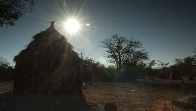 Medium wide angle Himba village with hut from before sunrise to mid morning