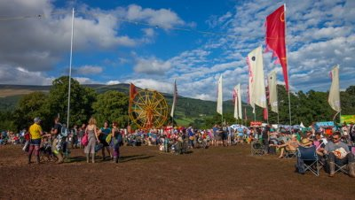 People sitting, moving around at Green Man festival 2012