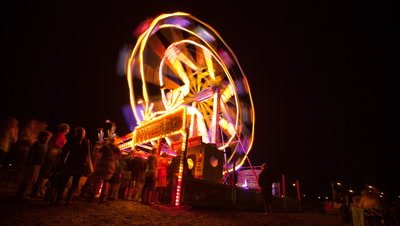 People on ferris wheel at night at Green Man festival 2012