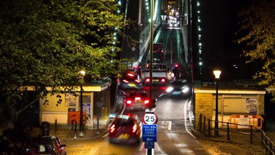 Traffic approaches Clifton suspension bridge at night