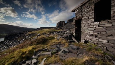 Abandoned former slate splitting shed on the site of Dinorwig Power Station in Llanberis, Wales. With the sun passing over the landscape