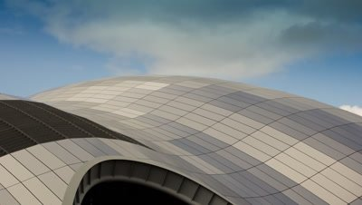 Mid shot of the roof of the sage as clouds pass over and create nice reflections over the roof.