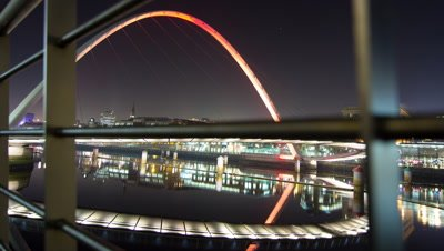 Shot through railings from a low angle of the Millennium Bridge on the Gateshead side of the River Tyne