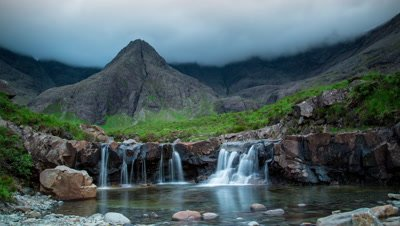 Wide shot at Fairy Pools looking towards Black Cullins with motion blur.