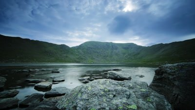 Motion control tracking shot with clouds reflecting onto lake. Red Tarn, looking at Helvellyn in the Lake District