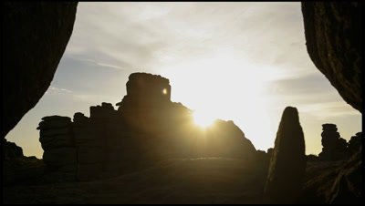 Sun rising over the eroded granite rock formation of Hound Tor, Dartmoor, Devon, UK
