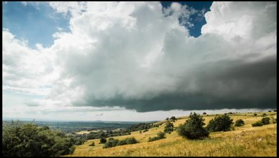 Heavy clouds rolling in across the Mendip Hills escarpment from the low lying Somerset Levels.