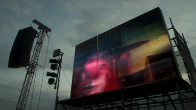 Low angle huge video wall showing band performing at The Big Chill Festival, Ledbury Castle UK