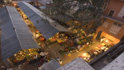 Medium wide angle top shot looking down on food market as dusk turns to night in Jaipur India
