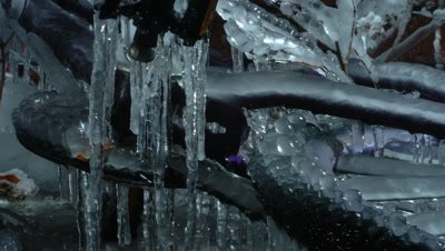 Close up of Child's purple bicycle freezes and is engulfed in ice
