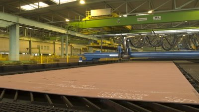 Medium wide angle steel cutting robot working on sheet steel in Aker Ship yard Germany