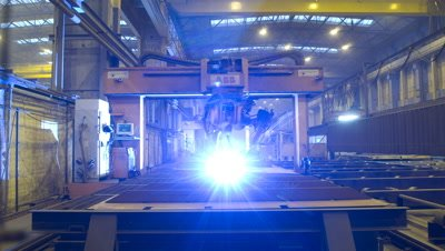 Medium wide angle welding robot moves over sheet metal for ship construction in Aker Ship yard Germany