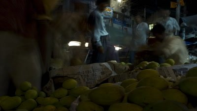 Mid shot looking out at busy street from mango stall at Bhagalpur Market