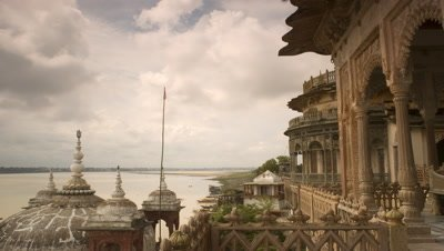 Medium wide angle palace frames River Ganges beyond with racing storm clouds getting progressively darker