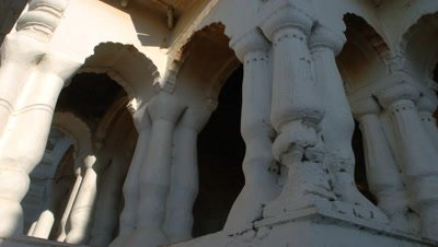 Mid shot sun and shadows over Bateshwar Temple column detail